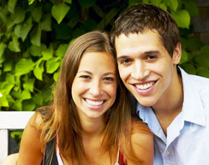 Smiling couple from Rockford, MI found laser dentistry near Grand Rapids at Stewart & Hull Aesthetic & General Dentistry.