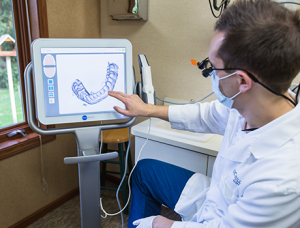Dr Hull shows off the advanced dental technology available in Comstock Park, including digital x-rays, and dental lasers.